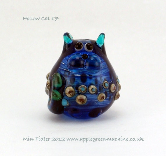 Streaky blue hollow cat bead 17