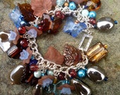 Blue Horizon - Chunky But Light Charm Bracelet with Blue and Brown Lampwork and Acrylic Beads and Tibetan Silver