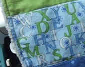 Quilted Baby Bib, blue and green alpha print