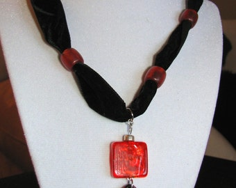 Black orange fire pendant necklace