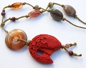 Cinnabar Koi Fish and Agate Donut pendant on long gemstone necklace