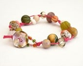 Pink cord bracelet with mixed gemstones and shell beads