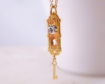 Gold door knob necklace - tiny doorknob with rhinestone handle and mini key charm on simple gold plated chain - Peeper