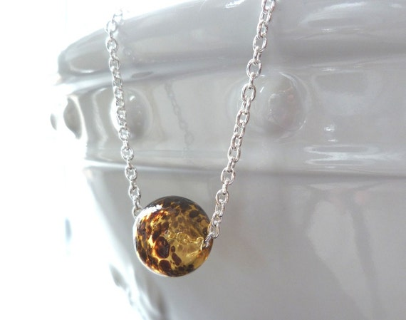 Leopard Print Necklace - simple hollow blown glass globe slider bead in amber, topaz, caramel brown spots - delicate silver chain with ball