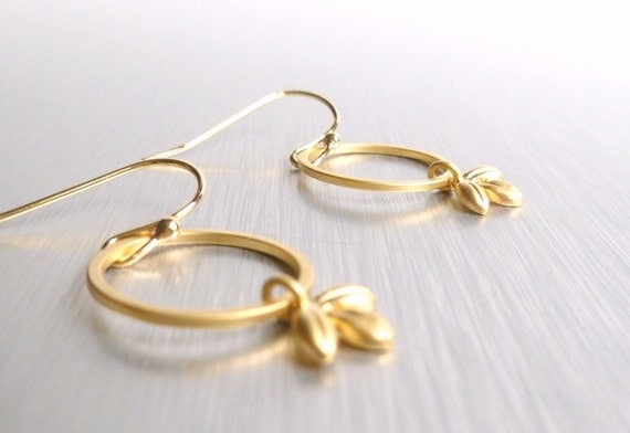 Gold leaf hoop earrings - small simple delicate matte leaflets dangle from matte round rings on polished yellow gold plated ear hooks