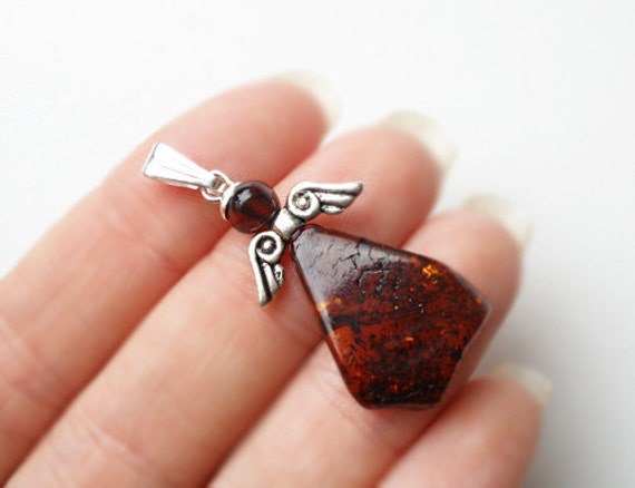 Angel pendant from natural Baltic amber