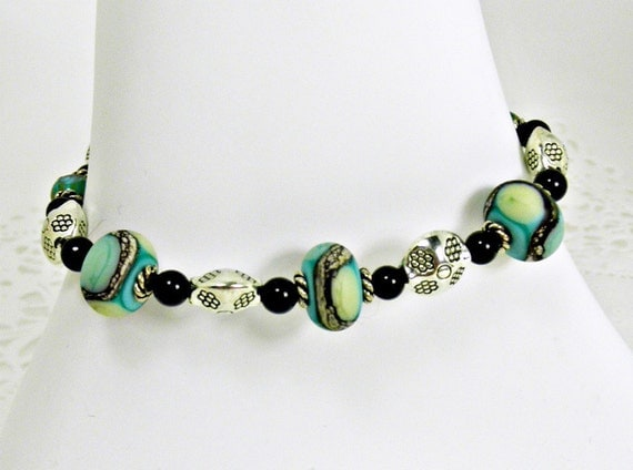 Aqua, Green, and Silver Lamp Work Bead, Silver Plated Spacers, & Black Stone Bracelet