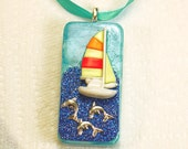 Domino pendant with ribbon necklace mixed media with 3D Sailboat and Dolphins