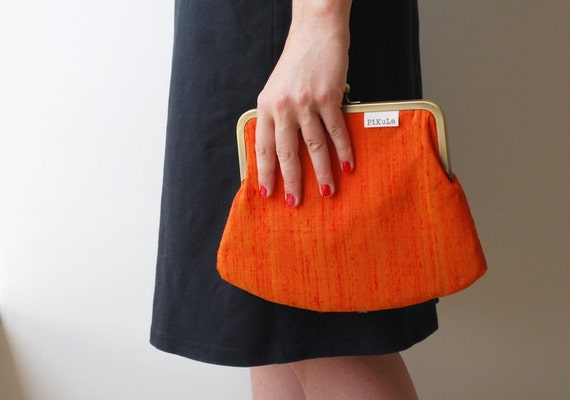 clutch purse. orange silk kiss lock purse. chain purse. snap purse