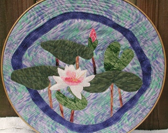 Round Framed Fabric Lily Pads and Water Art