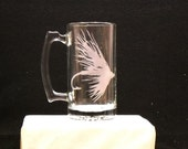 beer stein with fishing fly lure etched on it