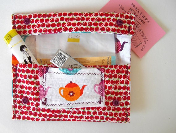 Tobacco pouch. Red apples and colorful teapots fabric