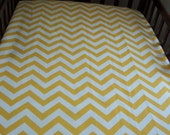 Crib or toddler bed fitted sheet. Shown in modern chevron print. Customize to match your bedding.