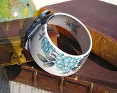 StayGoldMaryRose - Beautiful blue flower and grey leaf cluster pattern tea cup bracelet with frosted grey hand made satin bow.