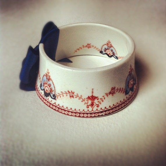 StayGoldMaryRose - Darling red and royal blue regal garland pattern tea cup bracelet with navy blue satin hand made bow.