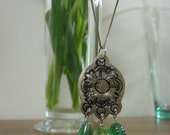 green and silver pendant