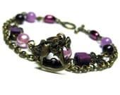 Beaded Bracelet, Double Strand Beaded Bracelet, Cube Bead, Purple Pearls, Rocking Horse Charm Bracelet, Pink Plum Bead Floral Charm: ANA