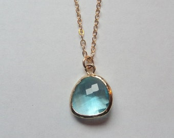 Light blue topaz aquamarine glass pendant charm on gold fill chain.  Everyday.  Bridal jewelry.  Simple and Classic.
