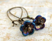 Blue and Purple Flower Earrings - Small iridescent blue and purple flower Czech glass beads, wire wrapped in antique brass