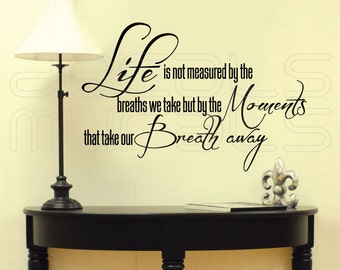 """Wall decals """"Life is not measured by the breaths we take...."""" VINYL LETTERING QUOTE interior decor by Decals Murals (15x22)"""