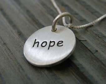sterling silver hope pendant necklace shown in hand matte finish