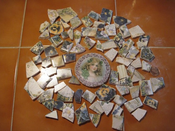 Great lot of floral broken tile pieces. Large central flower girl piece. Mosaic or jewelry making.