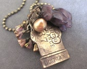 The New Puppy ...  vintage dog tag charm assemblage necklace ANIMAL RESCUE DONATION