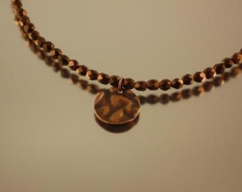 Bronze faceted round necklace with antique copper hammered coin pendant