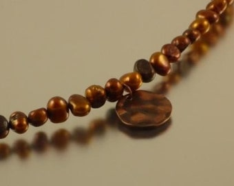 Brown  pearl necklace with hammered coin pendant