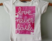 love never fails, hand painted organic cotton baby onesie or children's tee