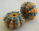 Sea urchin beads in porcelain with yellow, turquoise, orange and purple