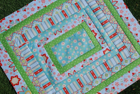 Riley Blake. DESIGNER Stroller Pram Quilt. Delighted by The Quilted Fish. QUILTED 30x34. Fleece back.