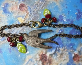 Bird and Cherries Bracelet - Antiqued oxidized brass flying swallow, deep red crystal fruits & olive green leaves -Rustic- free shipping USA