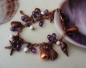 Seashore charm bracelet copper purple and shell beads-Neptune