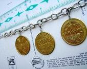 Tron Coin Charm Bracelet