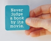 never judge a book square magnet