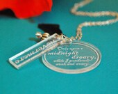 The raven engraved silhouette necklace