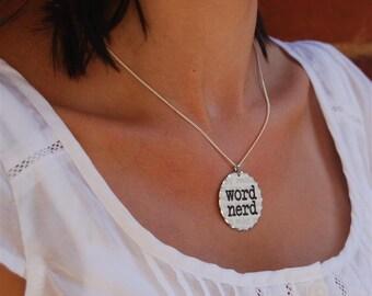 word nerd rhodium pendant necklace