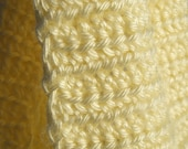 Soft creme or butter yellow colored crochet scarf