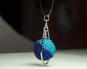 Beadwork pendant necklace in two moods of blue hand stitched one seed bead at a time on a BoonieBead