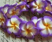 4 Flower Shaped Polymer Clay Beads