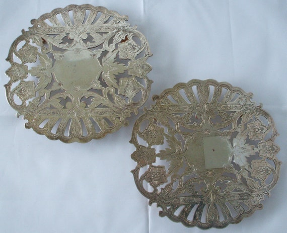 Two matching silver plated trivets made by the Wallace company