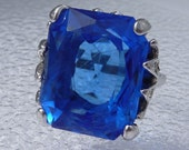 Uncas Sterling Ring with HUGE Royal Sapphire Blue Glass Stone