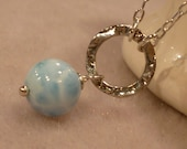 Large blue larimar smooth round bead pendant on large sterling silver hammered ring