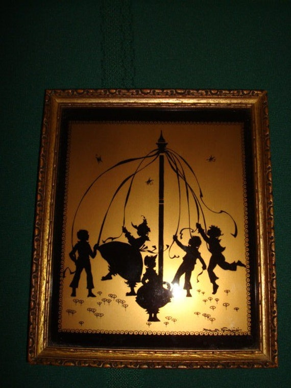 Gold and Black Silhouette Children Dancing Around the May Pole