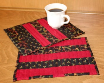 Mug Rugs Christmas Quilted Holly and Horns Snack Mats Red, Green, Black, Brass Horns, Ribbon