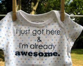 I just got here & I'm already awesome.  --- blue patterned bodysuit, size newborn