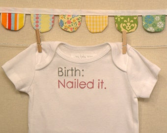 birth: nailed it --- white bodysuit, size 0-3 months --- pink