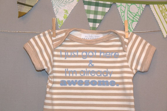 I just got here & I'm already awesome.  --- brown striped onesie, size 0 - 3 months.