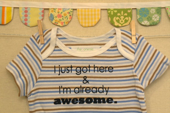 I just got here & I'm already awesome  --- blue striped onesie size 0-3 months.